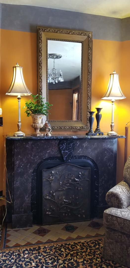 Robin Room mantle – Buffalo Harmony House